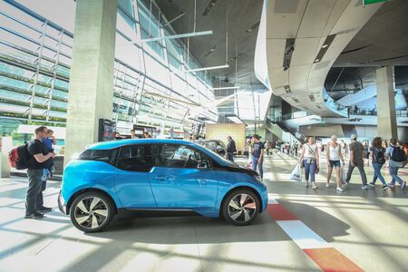 i3: MUNICH, GERMANY - MAY 6, 2017 : People sightseeing the exhibited BMW i3 automobile in the BMW Welt exhibition center in Munich, Germany.