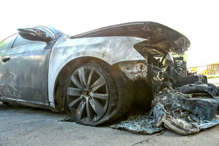 The exterior of a burned out car.