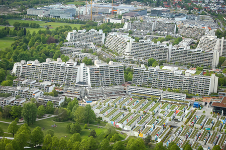 was: MUNICH, GERMANY - MAY 6, 2017 : Aerial view of the Olympic Village from Olympic Tower in Munich, Germany. The Olympic Village was used to house the athletes during the 1972 Summer Olympics.