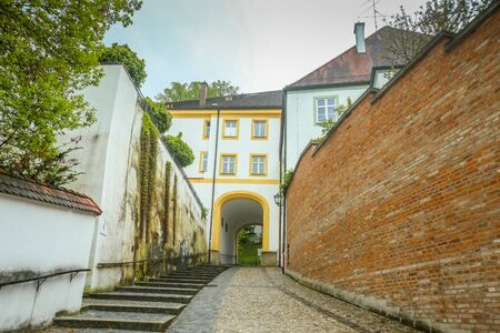 belfry: FREISING, GERMANY - MAY 8, 2017 : A view of the romanesque building with entrance to Domberg and basilica Saint Mary and Corbinian Cathedral in Freising, Germany. Editorial