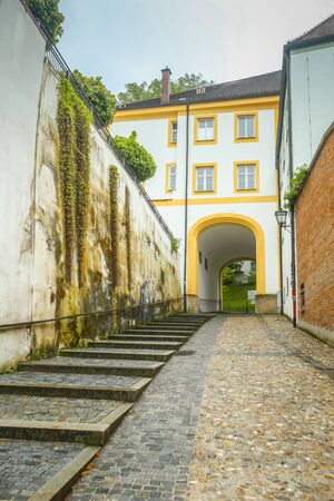 FREISING, GERMANY - MAY 8, 2017 : A view of the romanesque building with entrance to Domberg and basilica Saint Mary and Corbinian Cathedral in Freising, Germany. Editorial