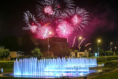 Brightly colorful fireworks above the city water fountains during the International fireworks festival in Zagreb, Croatia.