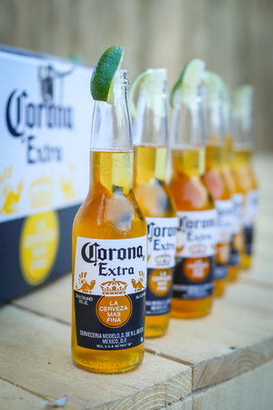 ZAGREB, CROATIA - JUNE 28, 2017 : Detail of lined up Corona beer bottles on the Corona Sunsets Session party on the roof of Zagreb Dance Center in center of Zagreb, Croatia.