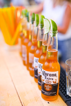 brewery: ZAGREB, CROATIA - JUNE 28, 2017 : Detail of lined up Corona beer bottles on the Corona Sunsets Session party on the roof of Zagreb Dance Center in center of Zagreb, Croatia.