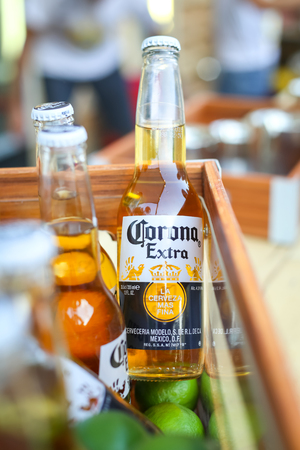 ZAGREB, CROATIA - JUNE 28, 2017 : Close up of Corona Extra beer bottle in a wooden box on the Corona Sunsets Session party on the roof of Zagreb Dance Center in center of Zagreb, Croatia.