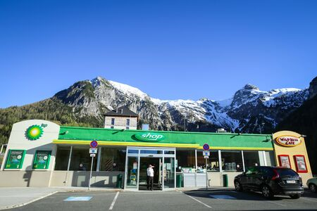 FLACHAU, AUSTRIA - MAY 10, 2017 : A BP gas station with a shop and the Landzeit Hotel on the highway rest stop in Alps environment in Flachau, Austria.