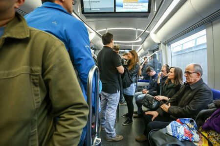 u bahn: MUNCHEN, GERMANY - MAY 9, 2017 : People in train on the subway system in Munich, Germany. About 350 million passengers ride the U-Bahn every year.