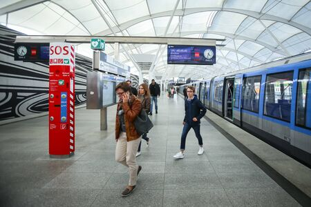 u bahn: MUNCHEN, GERMANY - MAY 9, 2017 : People in transit on the Frottmaning train station on the U6 subway line in Munich, Germany. About 350 million passengers ride the U-Bahn every year.