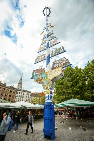 near beer: MUNICH, GERMANY - MAY 9, 2017 : A pole representing Munchner Reinheitsgebot at the outdoor food market near Marienplatz in Munich, Germany. Munchner Reinheitsgebot is german beer purity law, regulations limiting the ingredients in beer. Editorial