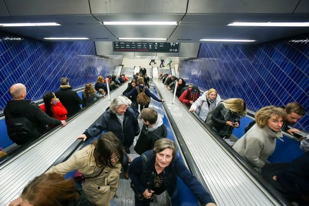 u bahn: MUNCHEN, GERMANY - MAY 9, 2017 : People on the escalator on the Marienplatz subway station in Munich, Germany. About 350 million passengers ride the U-Bahn every year.
