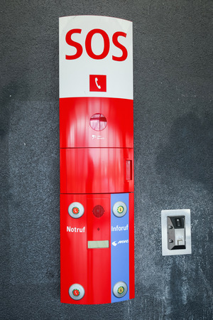 MUNICH, GERMANY - MAY 9, 2017 : An SOS defibrillator automat on the subway wall in Munich, Germany. Editorial