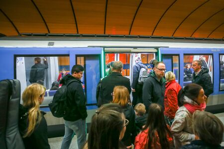 u bahn: MUNCHEN, GERMANY - MAY 9, 2017 : People in transit on the Marienplatz subway station in Munich, Germany. About 350 million passengers ride the U-Bahn every year. Editorial