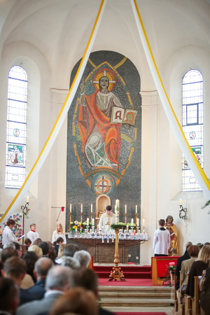 NANDLSTADT, GERMANY - MAY 7, 2017 : The priest holding the mass at the first communion in Nandlstadt, Germany.