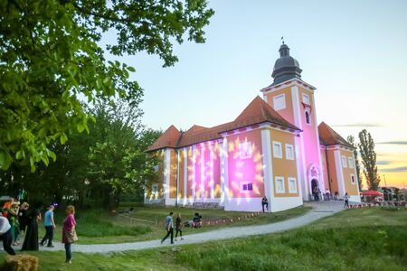 LUKAVEC, CROATIA - MAY 27, 2017 : People are visiting the Lukavec castle at sunset on the  Perunfest, festival of forgotten tales and folk tales held at Lukavec Castle in Lukavac, Croatia.