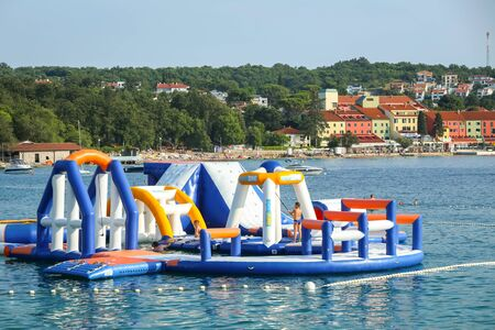 NJIVICE, CROATIA - JUNE 24, 2017 : People enjoying the amusement park on water in Njivice, Croatia. Editorial