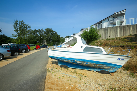 NJIVICE, CROATIA - JUNE 24, 2017 : A boat parked at a parking lot in Njivice, island of Krk, Croatia.