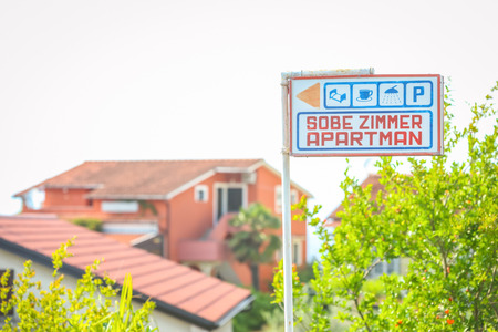 Apartment rental sign in front of house in Njivice, Krk, Croatia.