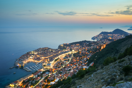 An aerial view of the ancient old town Dubrovnik at sunset in Dalmatia, Croatia.