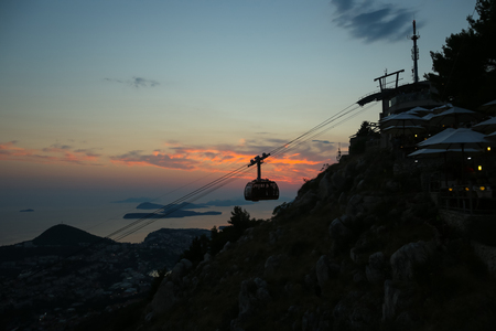 srd: DUBROVNIK, CROATIA - JULY 20, 2017 : Srd hill, a mountain behind the ancient old town Dubrovnik with cable car and restaurant in Dalmatia, Croatia.