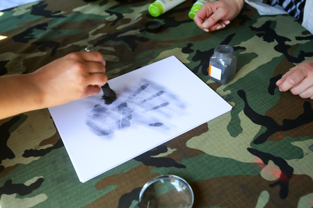 ZAGREB, CROATIA - MAY 28, 2017 : Forensic fingerprinting whole hand of visitors at the 26th anniversary of the formation of the Croatian Armed Forces on Lake Jarun in Zagreb, Croatia.