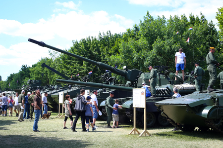 ZAGREB, CROATIA - MAY 28, 2017 : People sightseeing tanks, armored vehicles and howitzer exposed at 26th anniversary of the formation of the Croatian Armed Forces on Lake Jarun in Zagreb, Croatia.