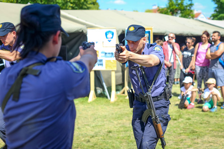ZAGREB, CROATIA - MAY 28, 2017 : Police training exercise with handgun at 26th anniversary of the formation of the Croatian Armed Forces on Lake Jarun in Zagreb, Croatia.