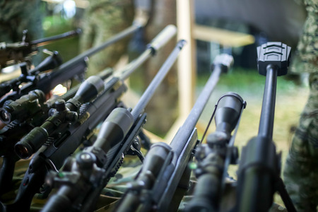 ZAGREB, CROATIA - MAY 28, 2017 : Detail of sniper rifles arranged in a row on the 26th anniversary of the formation of the Croatian Armed Forces on Lake Jarun in Zagreb, Croatia.