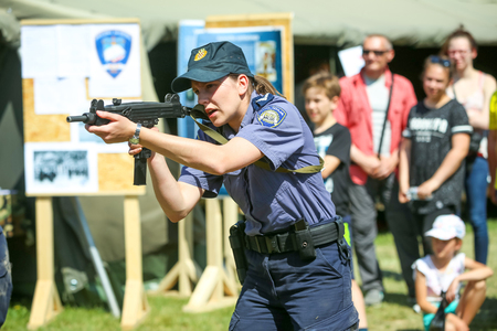 ZAGREB, CROATIA - MAY 28, 2017 : Police training exercise with machine gun Ero at 26th anniversary of the formation of the Croatian Armed Forces on Lake Jarun in Zagreb, Croatia.