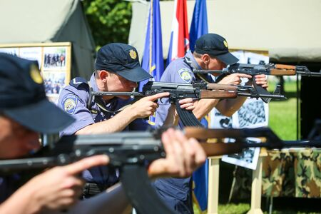 ZAGREB, CROATIA - MAY 28, 2017 : Police training exercise with machine gun AK 47 Kalasnjikov at 26th anniversary of the formation of the Croatian Armed Forces on Lake Jarun in Zagreb, Croatia.