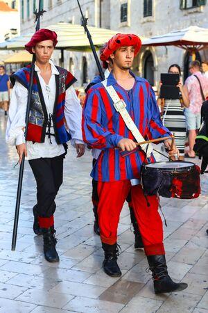 thru: DUBROVNIK, CROATIA - JULY 22, 2017 : Dubrovnik City Guard passing thru the Stradun street in the old city core in Dubrovnik, Croatia.