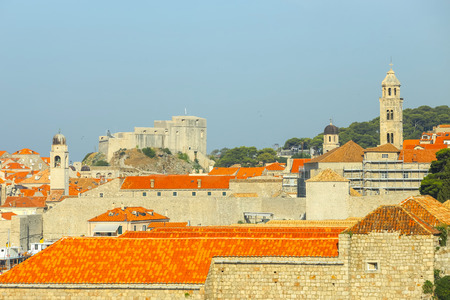 The city roofs with bell towers and fortress in Dubrovnik, Croatia. Editorial