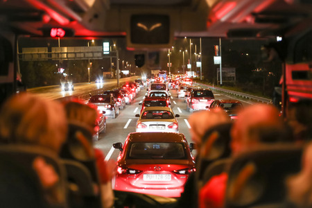 ZAGREB, CROATIA - NOVEMBER 5, 2017 : A view of a traffic jam through the windshield of a bus with passengers in Zagreb, Croatia.
