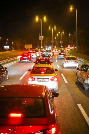 ZAGREB, CROATIA - NOVEMBER 5, 2017 : Cars lined up in a city traffic jam at night in Zagreb, Croatia.
