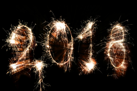 Isolated 2018 sign written with sparkle firework on black background, happy new year 2018 concept. Stock Photo