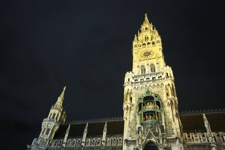 MUNICH, GERMANY - DECEMBER 11, 2017 : A low angle view of  the New Town Hall on Marienplatz at night in Munich, Germany.