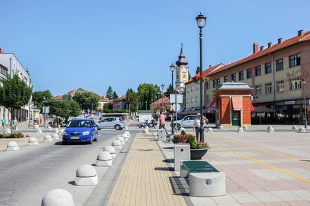 DARUVAR, CROATIA - AUGUST 16, 2013 : The car is driving around the King Tomislav Square in the center of Daruvar, Croatia.