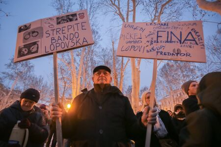 ZAGREB, CROATIA - 3rd MARCH, 2018 : Protester with boards protesting against the financial enforcement law, that is terrorizing financially blocked people, in Zrinjevac Park, Zagreb, Croatia. Editorial