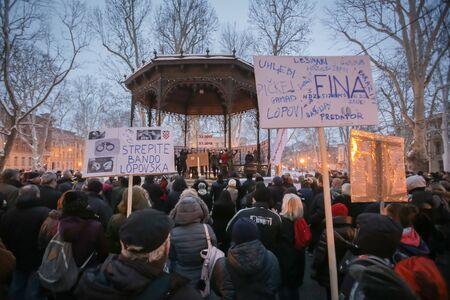 ZAGREB, CROATIA - 3rd MARCH, 2018 : Protesters with boards protesting against the financial enforcement law, that is terrorizing financially blocked people, in Zrinjevac Park, Zagreb, Croatia.