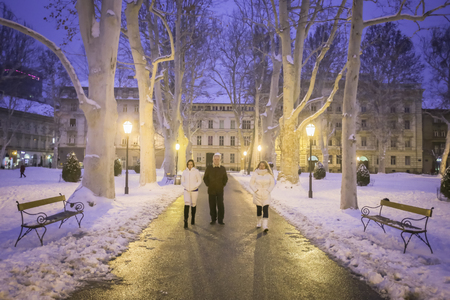 ZAGREB, CROATIA - 3rd MARCH, 2018 : People walking in Zrinjevac Park during blue hour at evening in winter in Zagreb, Croatia.