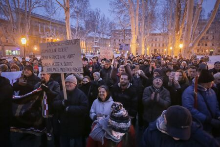 ZAGREB, CROATIA - 3rd MARCH, 2018 : Protesters with boards protest against the financial enforcement law that is terrorizing financially blocked people, in Zrinjevac Park, Zagreb, Croatia.