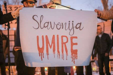 ZAGREB, CROATIA - 3rd MARCH, 2018 : Sign Slavonija is dying on the protest against the financial enforcement law that is terrorizing financially blocked people, in Zrinjevac Park, Zagreb, Croatia.