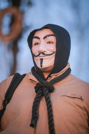 ZAGREB, CROATIA - 3rd MARCH, 2018 : Man dressed as anonymous protesting against the financial enforcement law, that is terrorizing financially blocked people, in Zrinjevac Park, Zagreb, Croatia.