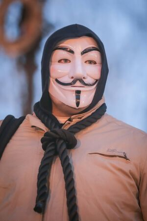 ZAGREB, CROATIA - 3rd MARCH, 2018 : Man dressed as anonymous protesting against the financial enforcement law, that is terrorizing financially blocked people, in Zrinjevac Park, Zagreb, Croatia. Stock Photo - 98649687