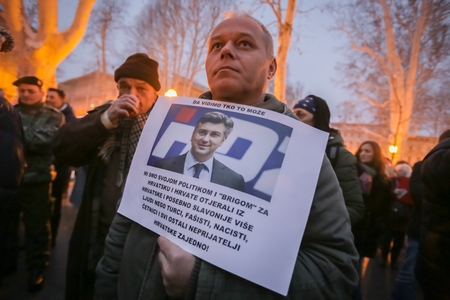 ZAGREB, CROATIA - 3rd MARCH, 2018 : Man holding a sign with portrait of prime minister Andrej Plenkovic on protest against the financial enforcement law in Zrinjevac Park, Zagreb, Croatia.