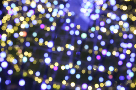 Abstract blurry illuminated background of Christmas decoration. Stok Fotoğraf