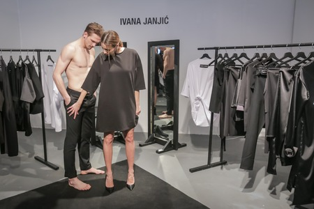 ZAGREB, CROATIA- MARCH 16, 2018: Concept CITY NEW NOW performance with fashion model dressing up clothes for spring-summer, designed by Ivanja Janjic on the Bipa Fashion.hr fashion show in Zagreb, Croatia.