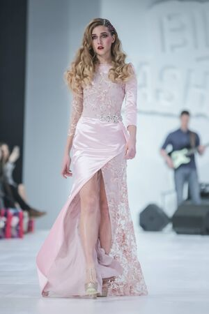 ZAGREB, CROATIA - MARCH 21, 2018 : Fashion model wearing clothes for spring - summer, designed by Ivica Skoko on the Bipa Fashion.hr fashion show in Zagreb, Croatia.