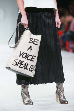 ZAGREB, CROATIA- MARCH 24, 2018: Fashion model wearing clothes for spring-summer, designed by Marina Design on the Bipa Fashion.hr fashion show in Zagreb, Croatia. Be a voice speak out message.