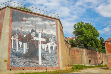 VUKOVAR, CROATIA - MAY 14, 2018 : Mural of a mother crying over the graves of the sons on the city walls in Vukovar, Croatia.