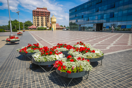 VUKOVAR, CROATIA - MAY 14, 2018 : Flower pots on the promenade with the Hotel Dunav in the background in Vukovar, Croatia.